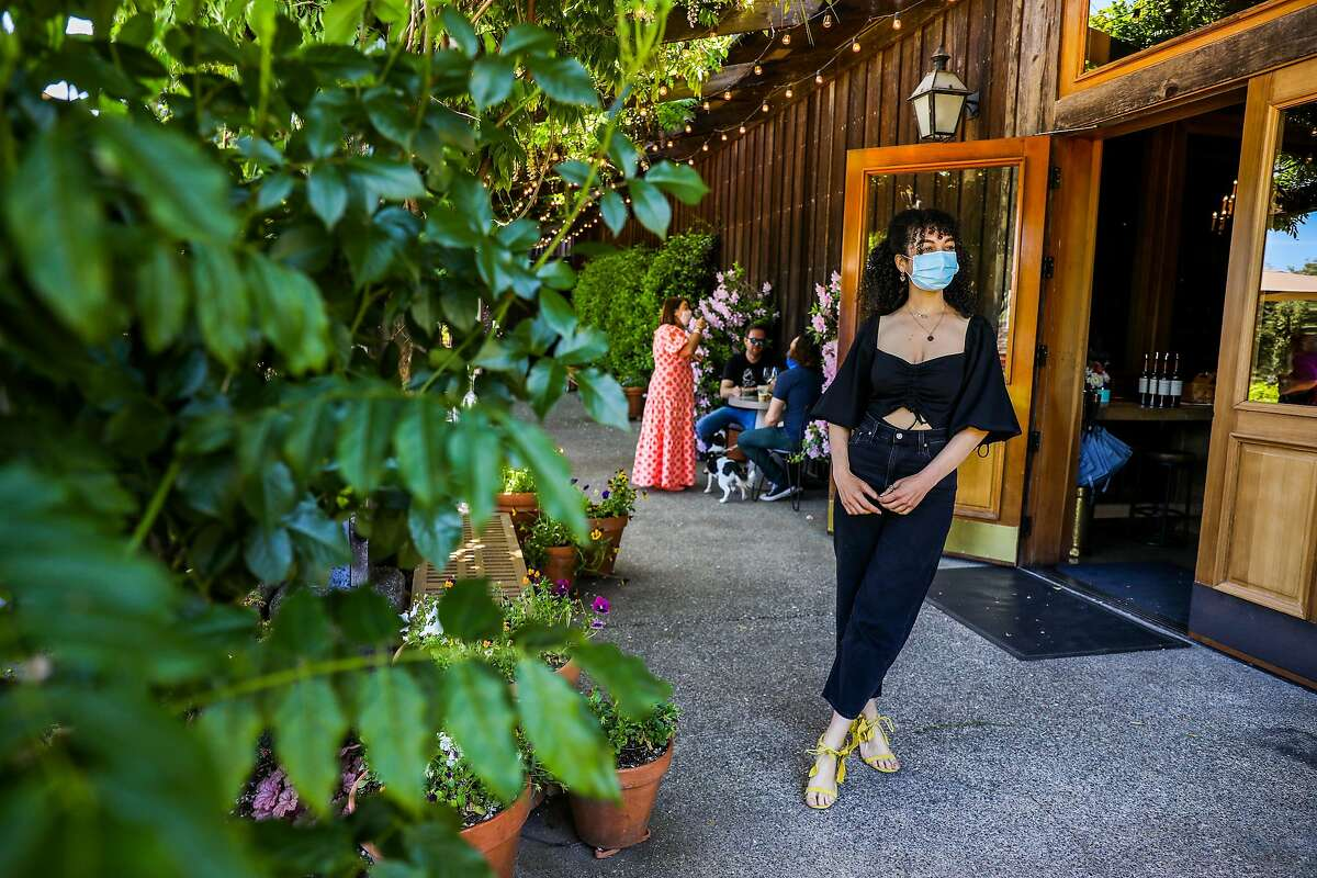 Instagram wine influencer Amber Lucas poses for a portrait as a friend takes photos of her at Lambert Bridge Winery in Healdsburg.