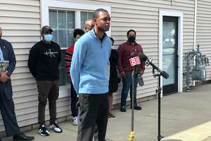 Samod Rankins, a lieutenant with the New Haven Fire Department, speaks at a press conference Friday about the city's proposed lottery system to break a 99-way tie on the entrance exam for new firefighters.