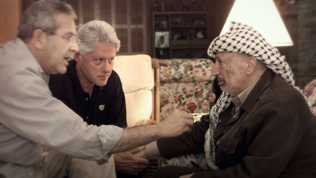From left, interpreter Gamal Helal, President Bill Clinton and Palestine Liberation Organization Chairman Yasser Arafat at Camp David in 2000, as shown in the documentary
