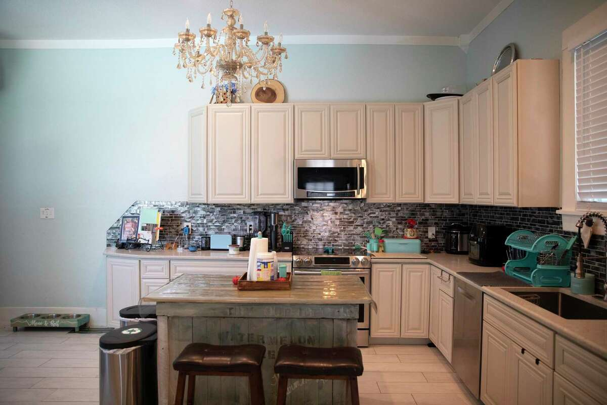 The modern kitchen had too few electrical outlets, so the couple added several more.