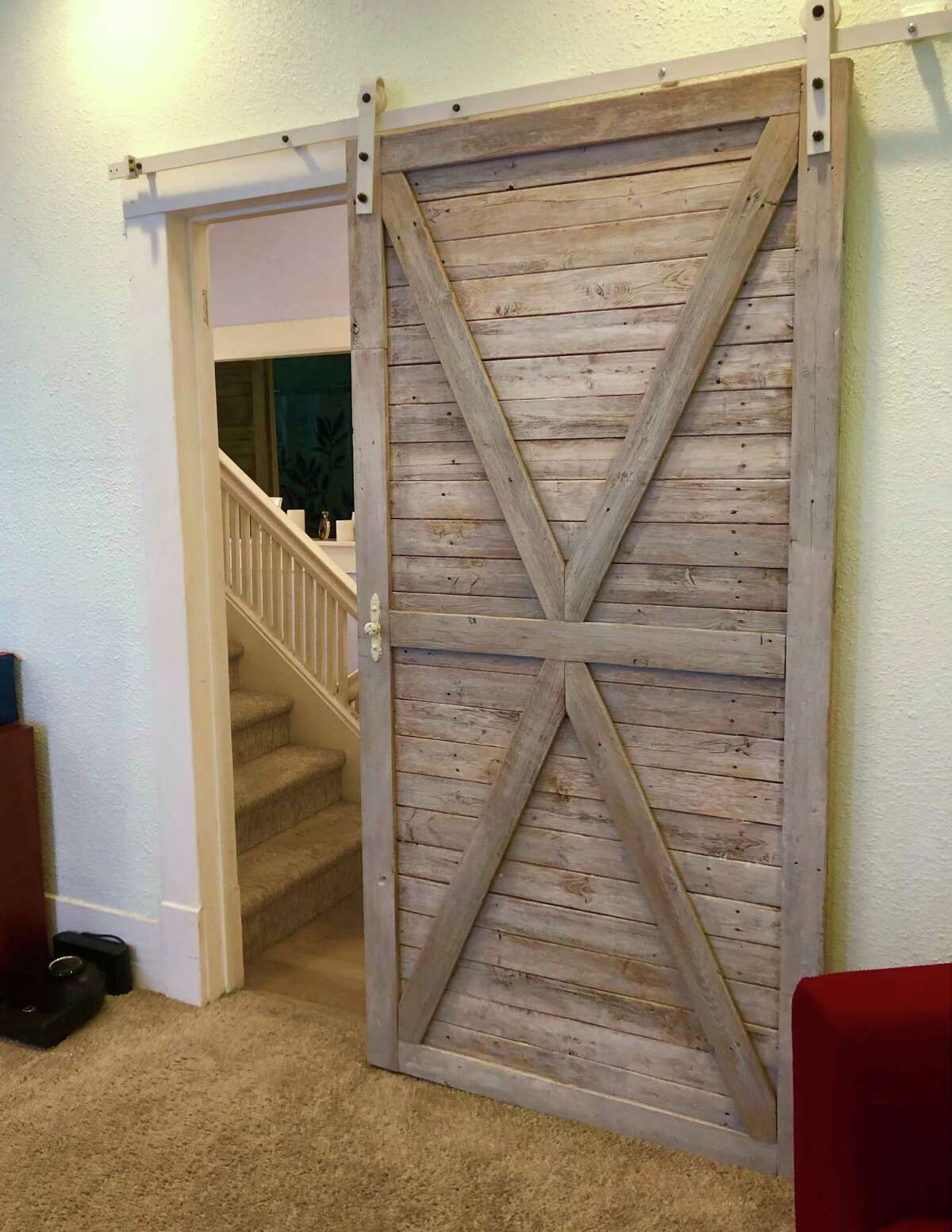 There are several farmhouse-style barn doors throughout the house.