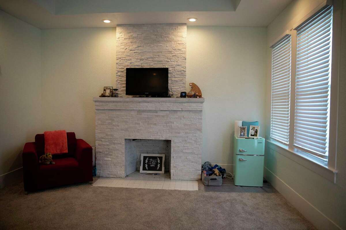 The master bedroom is complete with a fireplace.