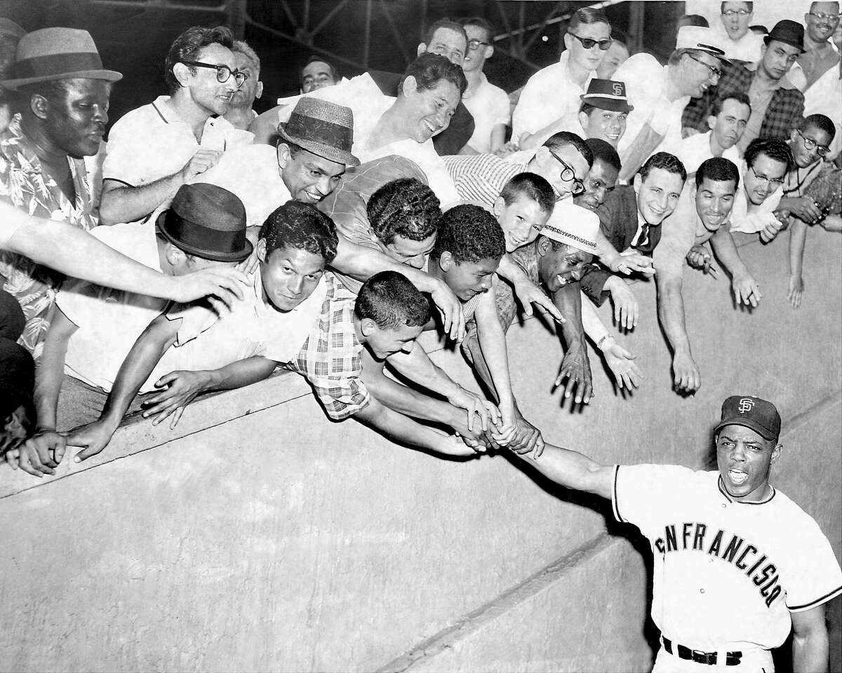 Fans at the Polo Grounds in New York greet the Giants' Willie Mays before a game in June 1962, during the Mets' inaugural season. Mays hit his 17th home run of year that night off future Giants manager Roger Craig.