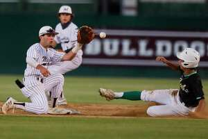 Magnolia shortstop Tyler Middleton (1) tries to apply a tag to Ethan Jezierski #5 of Brenham during the fifth inning of a District 20-5A high school baseball game at Magnolia High School, Tuesday, April 20, 2021, in Magnolia.