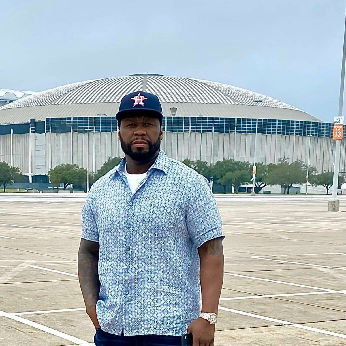 Rapper 50 Cent poses in front of Reliant after announcing on social media he's moved to Houston.