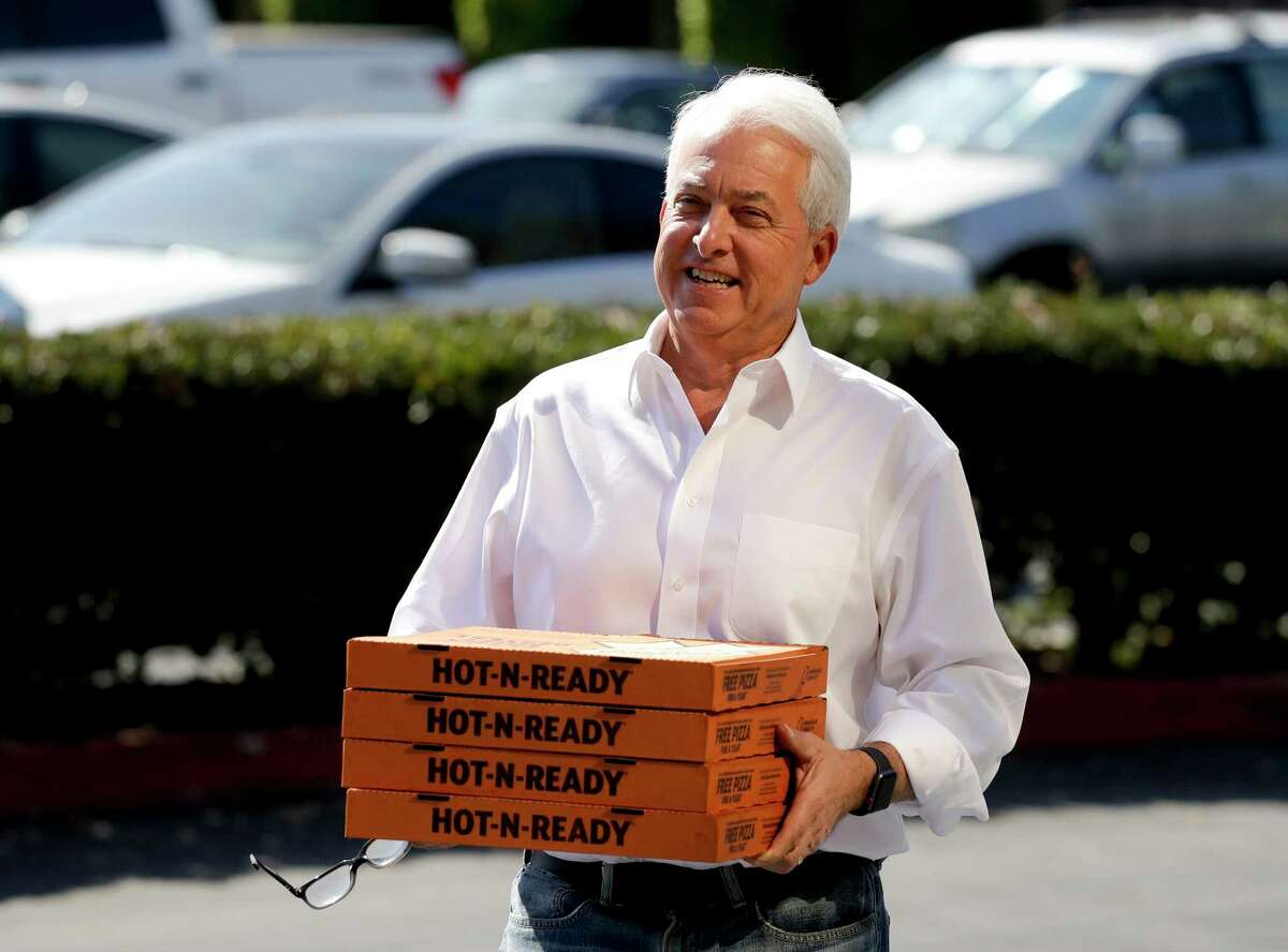 FILE - In this Nov. 6, 2018, file photo, Republican gubernatorial candidate John Cox brings lunch to the offices of Rep. Mimi Walters, R-Calif., in Irvine, Calif.