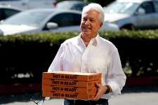 FILE - In this Nov. 6, 2018, file photo, Republican gubernatorial candidate John Cox brings lunch to the offices of Rep. Mimi Walters, R-Calif., in Irvine, Calif. Cox and Caitlyn Jenner, two Republicans running to oust California Gov. Gavin Newsom, sought to make a fresh impression with voters Tuesday, May 4, 2021, with the release of new campaign ads, marking a new phase in the pending recall.