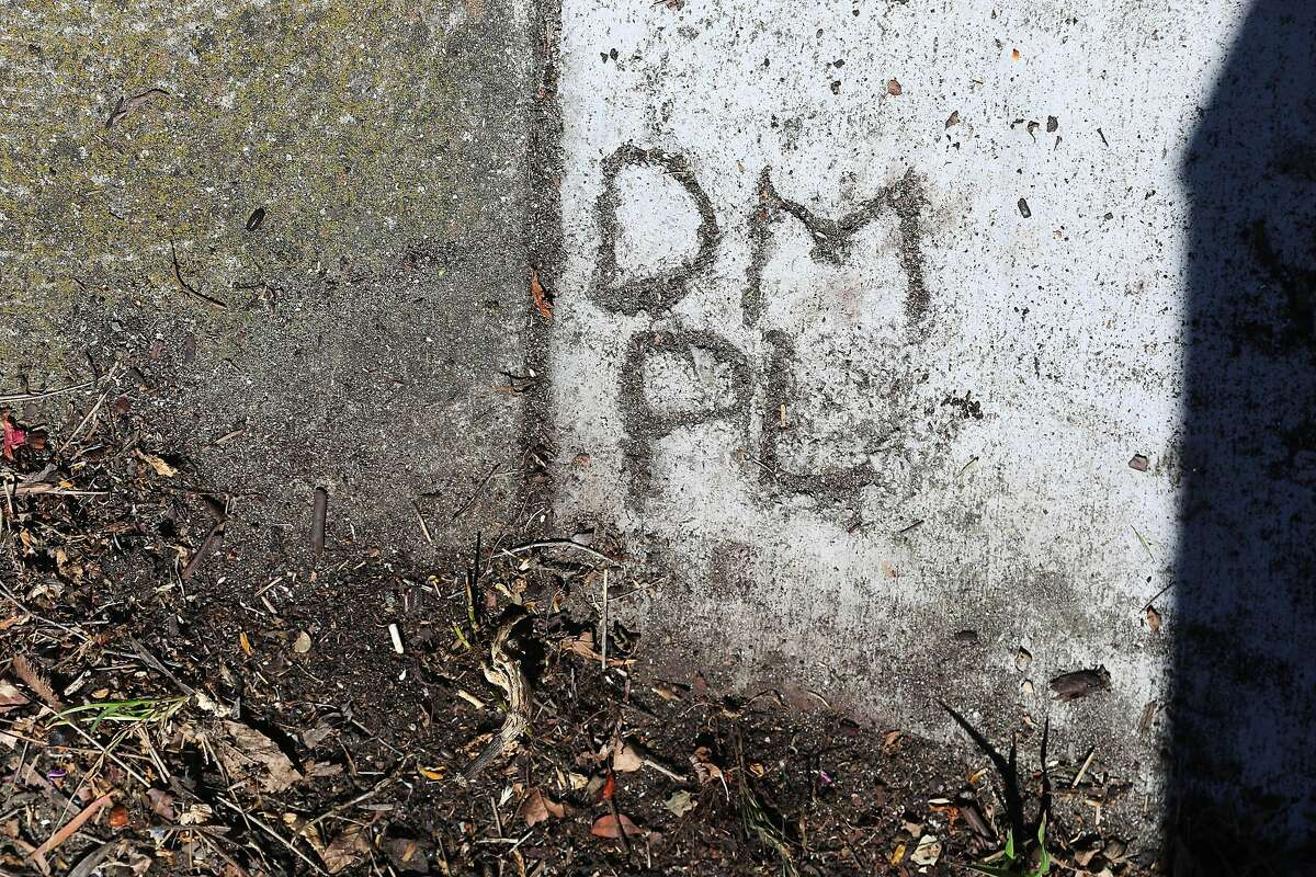 The initials of Phyllis Lyon and Del Martin are carved into the sidewalk in front of their house.