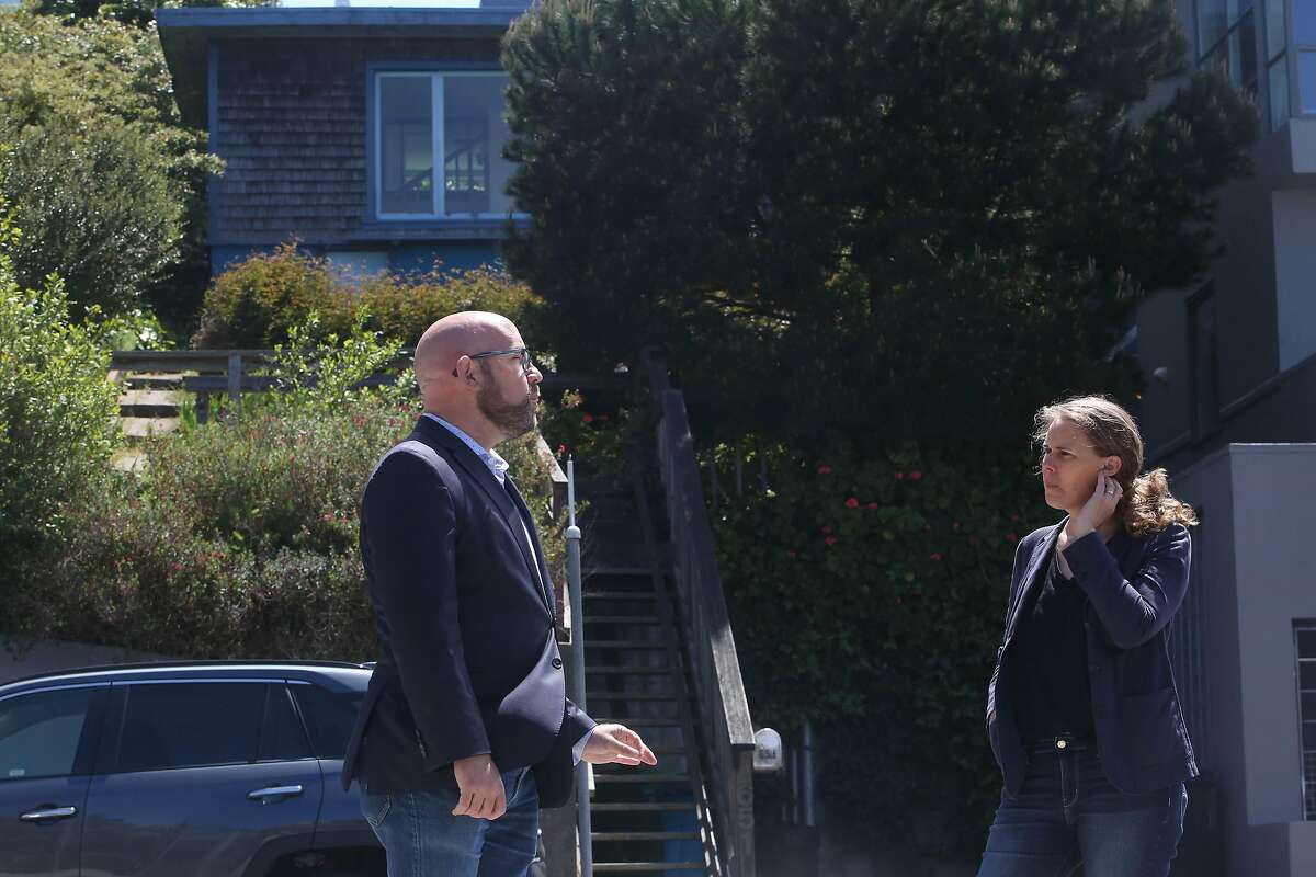 S.F. Supervisor Rafael Mandelman (left) and historian Shayne Watson talk in front of the former home of the late Phyllis Lyon and Del Martin.