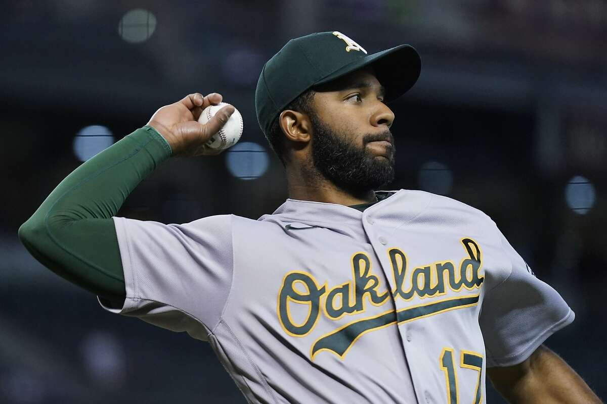 Oakland Athletics shortstop Elvis Andrus warms up prior to a baseball game against the Arizona Diamondbacks Tuesday, April 13, 2021, in Phoenix. (AP Photo/Ross D. Franklin)