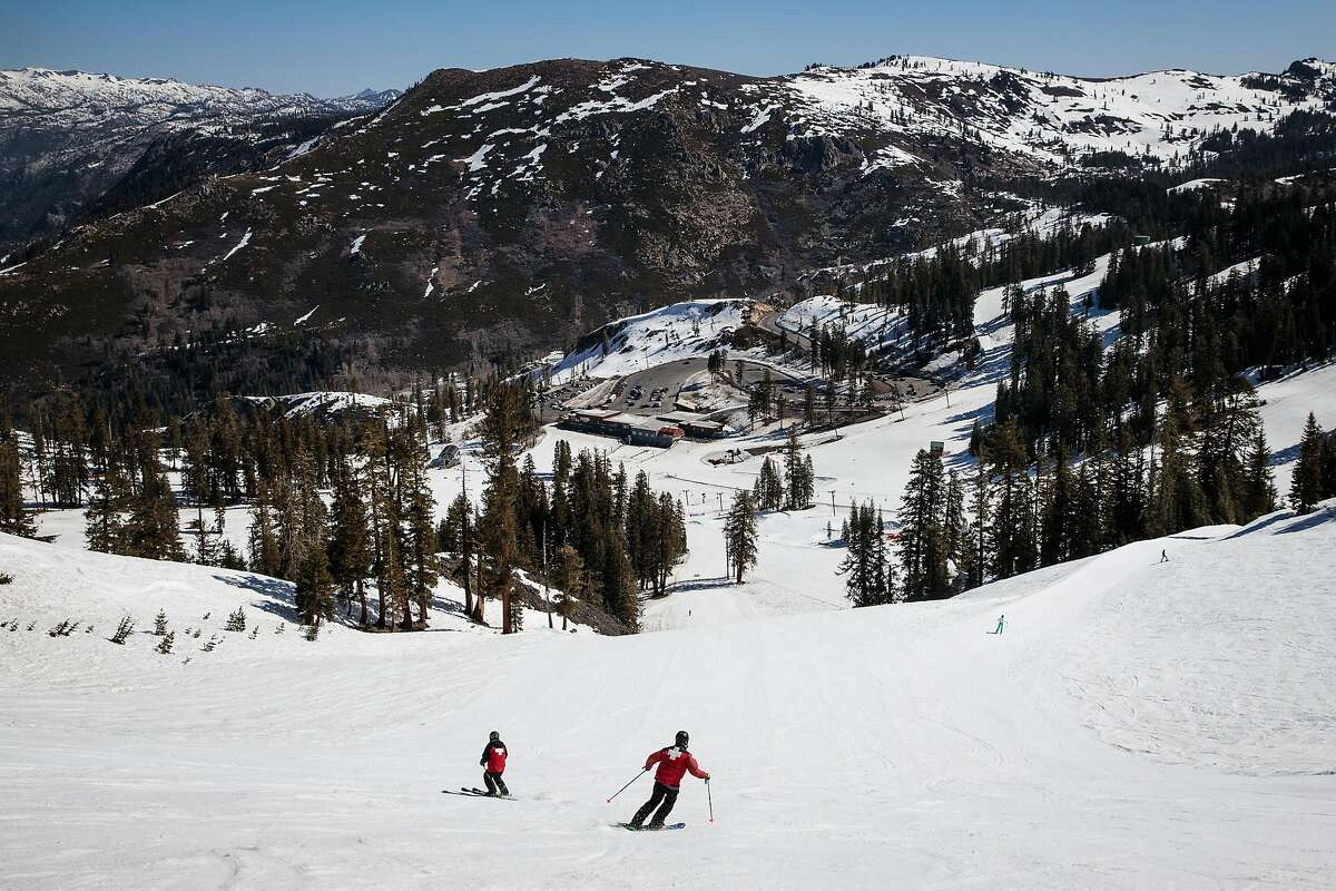 Ski patrollers work at Bear Valley Ski Resort.