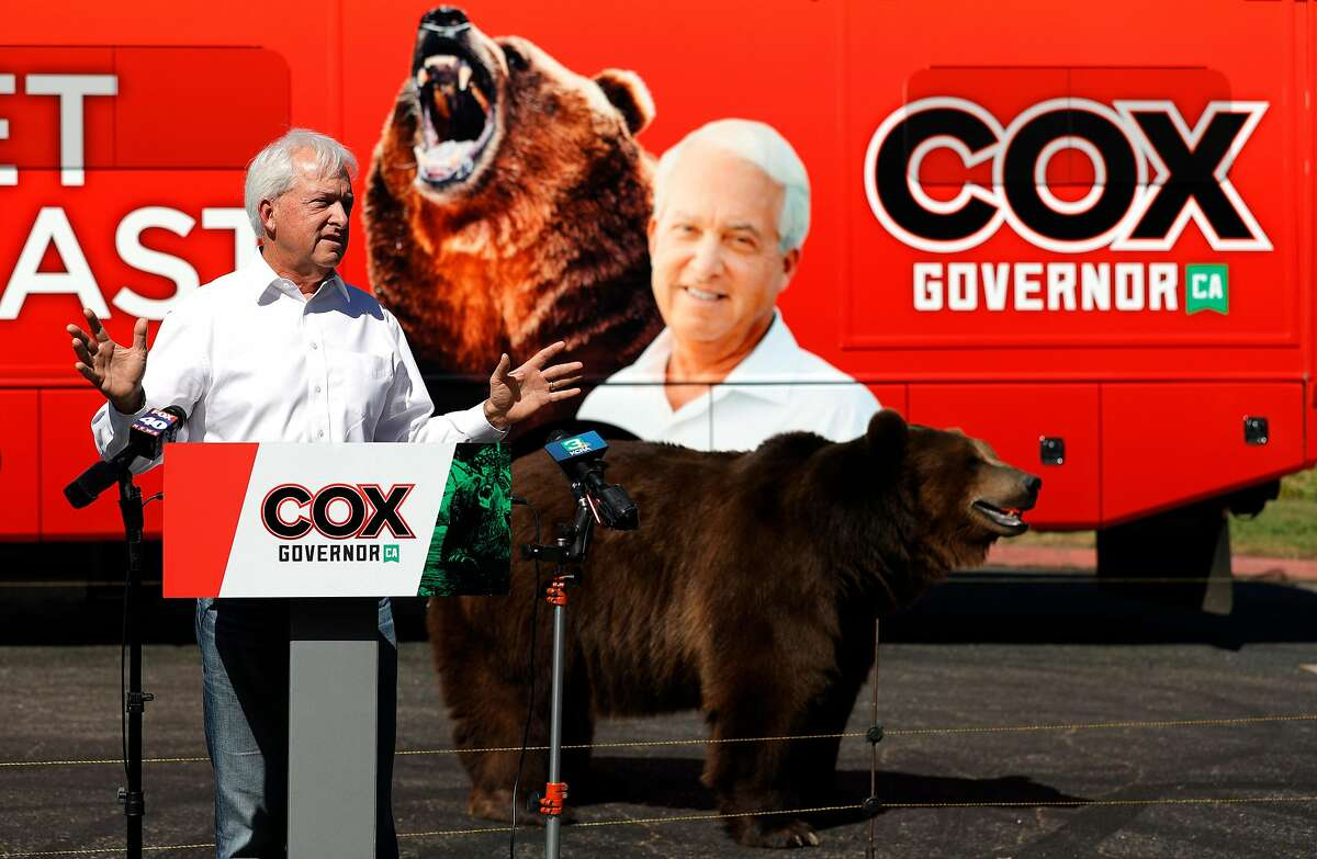 Gubernatorial hopeful John Cox campaigns with a 1,000-pound bear as a prop at Miller Regional Park in Sacramento.