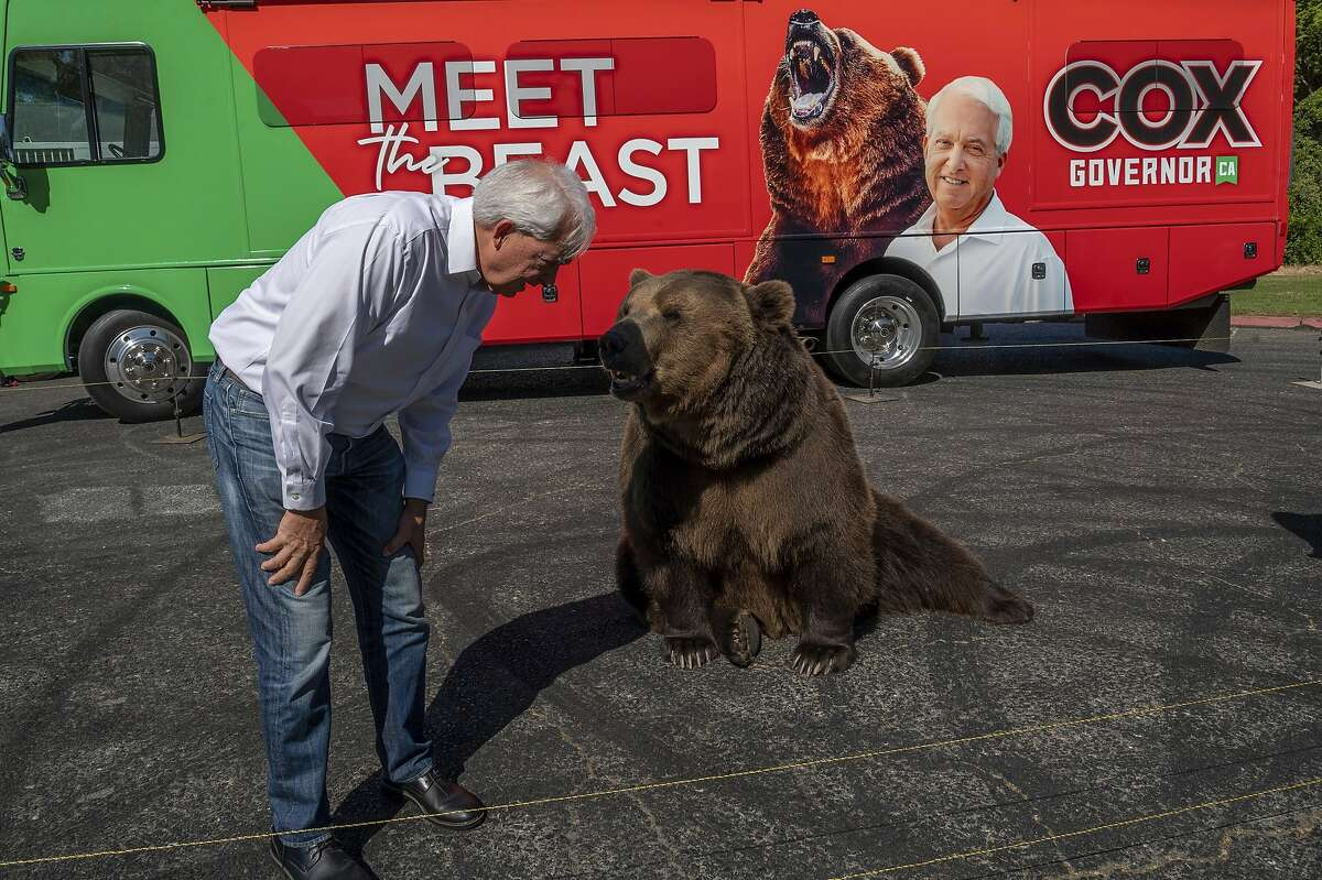 """John Cox, GOP candidate for governor in the recall election begins his statewide """"Meet the Beast"""" bus tour with Tag the bear in Sacramento."""