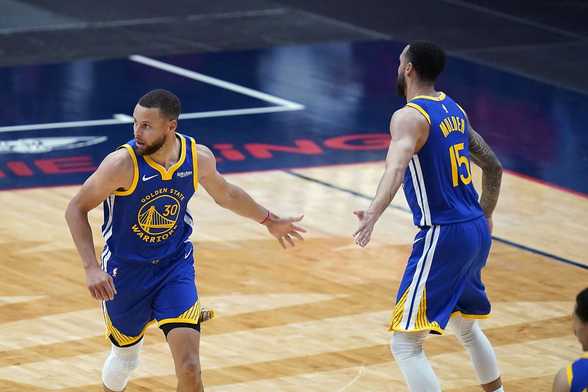 Golden State Warriors guard Stephen Curry (30) celebrates his basket with guard Mychal Mulder (15) in the second half of an NBA basketball game against the New Orleans Pelicans in New Orleans, Monday, May 3, 2021. The Warriors won 123-108. (AP Photo/Gerald Herbert)