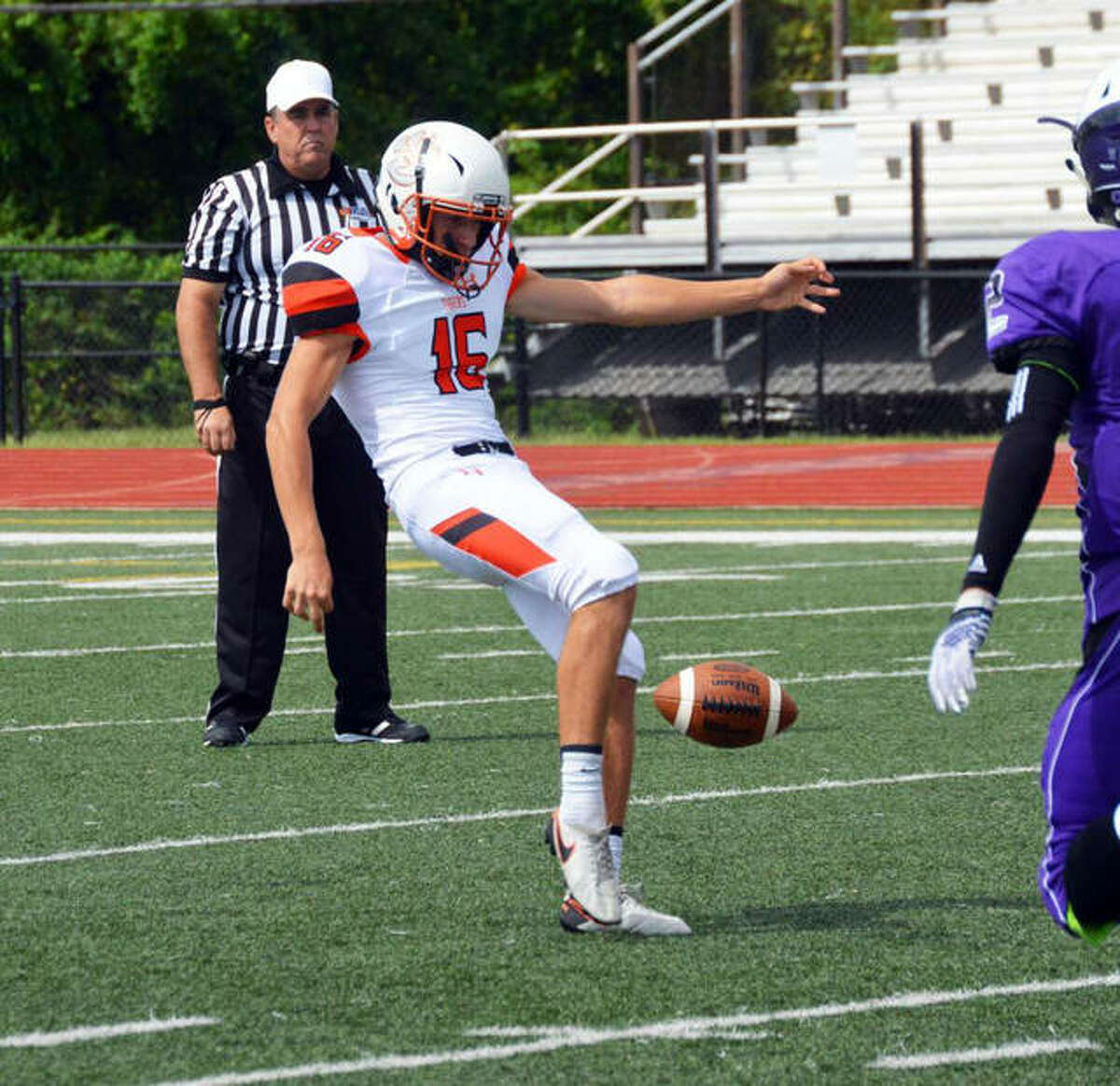 In this file photo, Edwardsville punter Riley Patterson blasts a kick down the field against the Collinsville Kahoks in the third quarter.