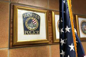 A logo for the Hamden Police Department, as seen in the government center.