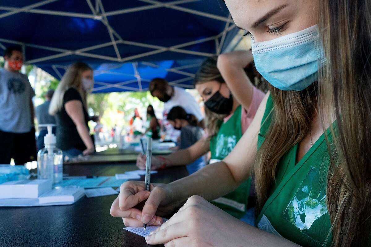 Rebecca Krickovich, a MedSci student, volunteer at the vaccination site at Vacaville High School in Vacaville, California.