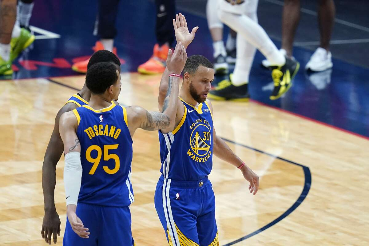 Golden State Warriors guard Stephen Curry (30) celebrates with forward Juan Toscano-Anderson (95) in the second half of an NBA basketball game against the New Orleans Pelicans in New Orleans, Monday, May 3, 2021. The Warriors won 123-108. (AP Photo/Gerald Herbert)