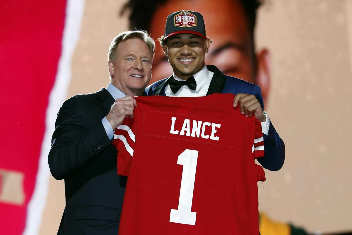 North Dakota State quarterback Trey Lance, right, holds a jersey with NFL Commissioner Roger Goodell after being chosen by the San Francisco 49ers with the third pick in the first round of the NFL football draft Thursday April 29, 2021, in Cleveland.