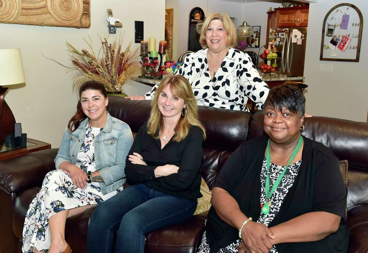 Members of Hamden Youth Connections, a new local nonprofit that aims to connect youth with mentors, from left, treasurer Dayna Kasprzychi, secretary Victoria Simiola, founder and CEO Cheryl Kasprzychi and Vice President Kimberly Washington.
