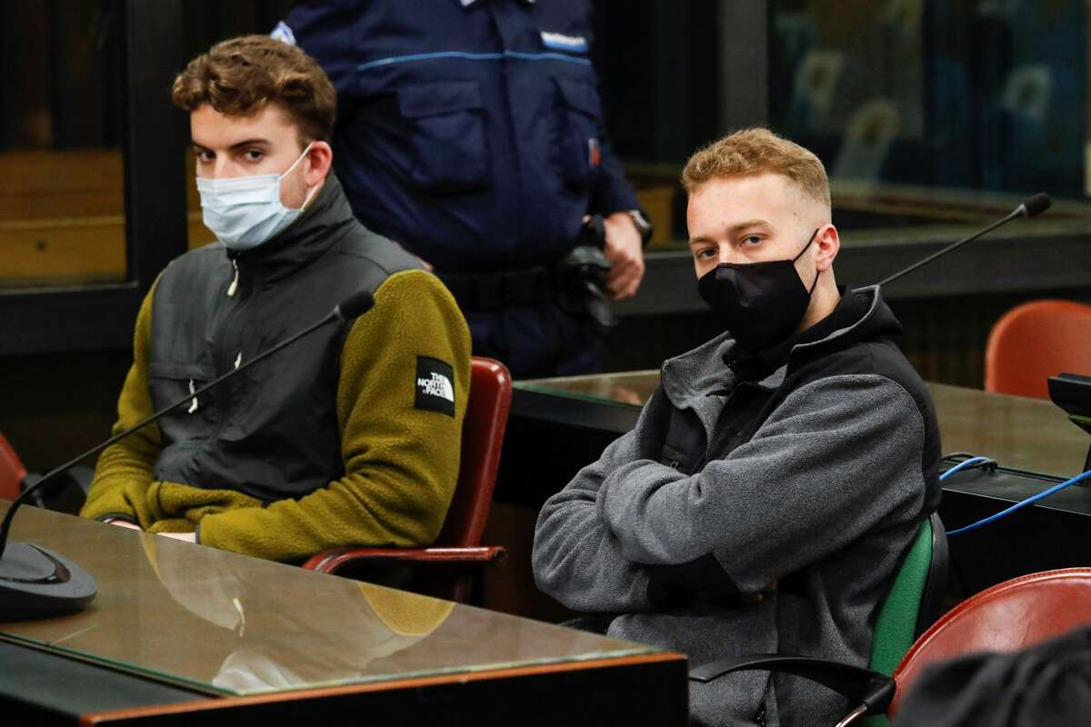 Finnegan Lee Elder (right) and Gabriel Natale-Hjorth look on during a break in closing arguments in Rome on April 26, 2021.