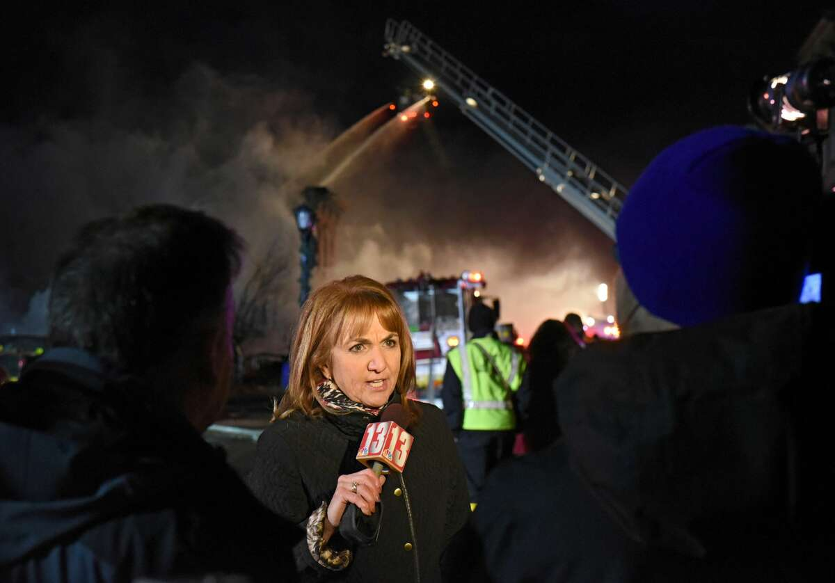 Benita Zahn and other members of the media report live as firefighters from around the region work to control a multi-structure fire on Remsen Street on Thursday, Nov. 30, 2017 in Cohoes, N.Y. (Lori Van Buren / Times Union)