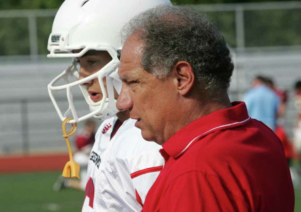 Greenwich High School head football coach Rich Albonizio speaks with starting quarterback Mike Lefflbine during a practice session earlier this season.