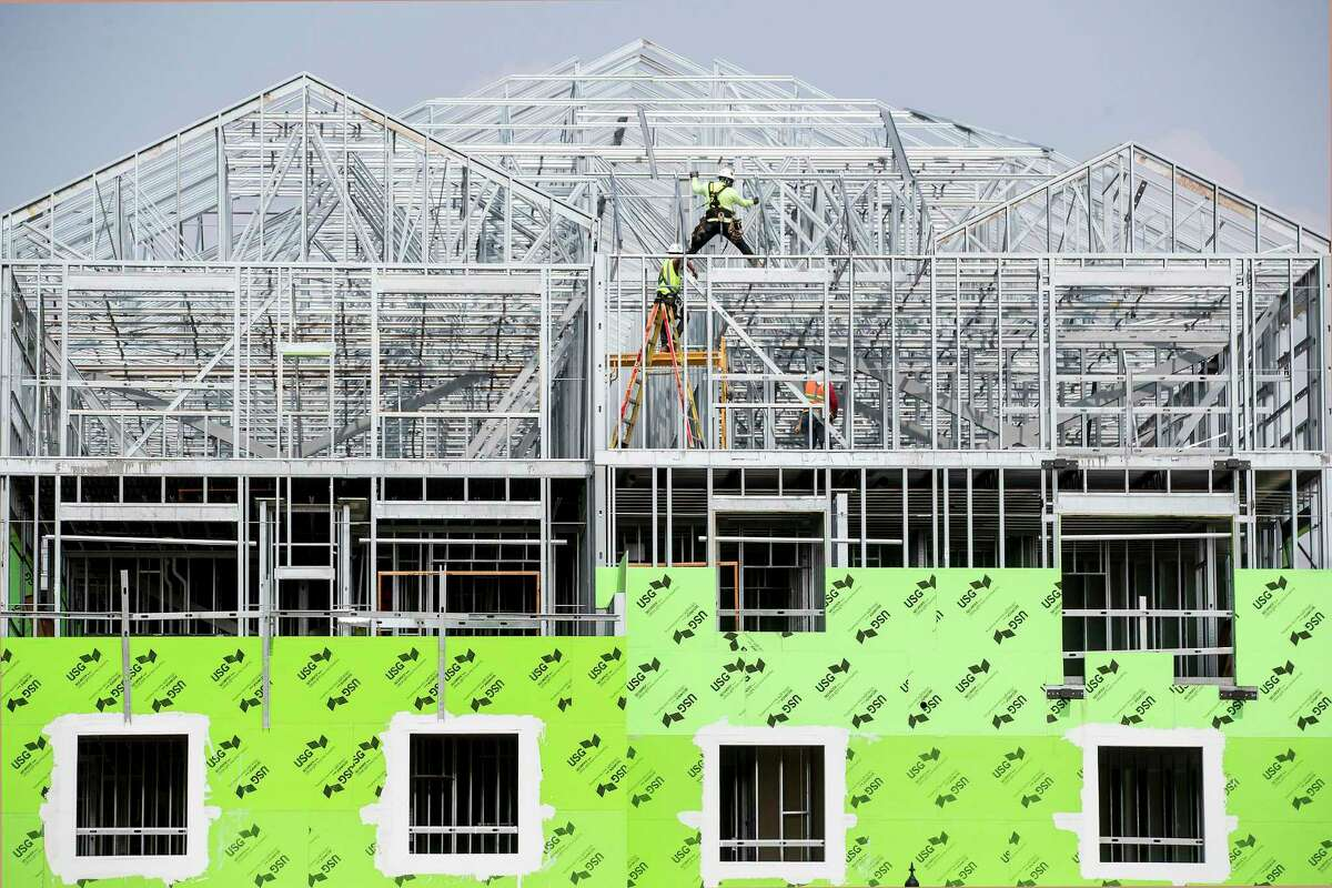 Construction workers build a multi-family complex on Tuesday, May 4, 2021 in Missouri City. Texas continues to lead the United States in raw population growth, according to Census estimates released Tuesday. The state's suburbs also continued swelling. Collin and Denton counties are projected to have larger population increases than Harris County, for example. Meanwhile, Fort Bend County is expected to record the sixth-largest population increase in the country. There were 373,965 more Texas residents in 2020 than in 2019 - marking the biggest increase since 2017 - according to the estimates, which don't incorporate the 2020 Census results.