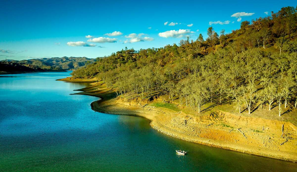 Men fish near Pleasure Cove at Lake Berryessa, which is in better shape than nearby Lake Sonoma and Lake Mendocino.