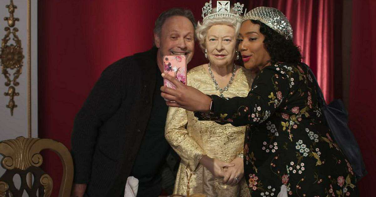 Co-writer, director and star, Billy Crystal, left, poses with co-star Tiffany Haddish, right, and in the center, Helen Mirren, er, Queen Elizabeth II, we mean, a wax figure of Queen Elizabeth II, in a scene from