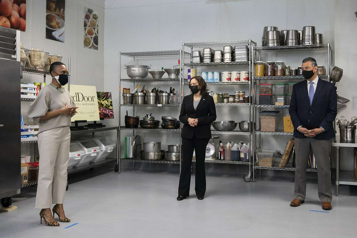Red Door Catering owner Reign Free (left) speaks with Vice President Kamala Harris and Sen. Alex Padilla.