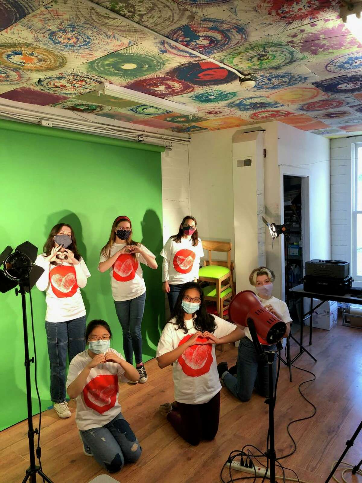 From left, front row, Yaeyoung Min, Ishaani Pradeep, Riley Mahon. From left, back row, Bianka Laufer, Annabelle Colonna, Owen Kent, working on promotional video for the New Milford My Heart Beats For initiative.