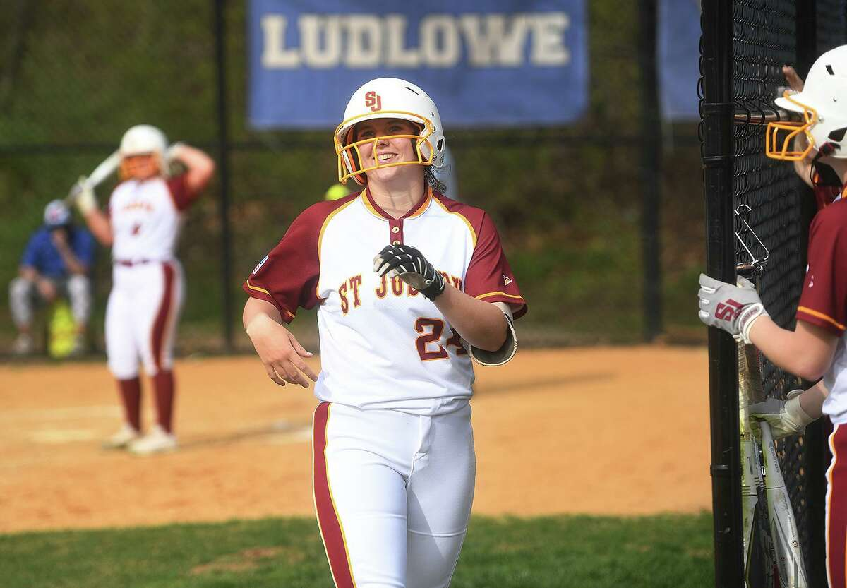 St. Joseph's Maddy FitzGerald smiles as she returns to the dugout after hitting a home run in the 3rd inning against Fairfield Ludlowe at Sturges Park in Fairfield in April.