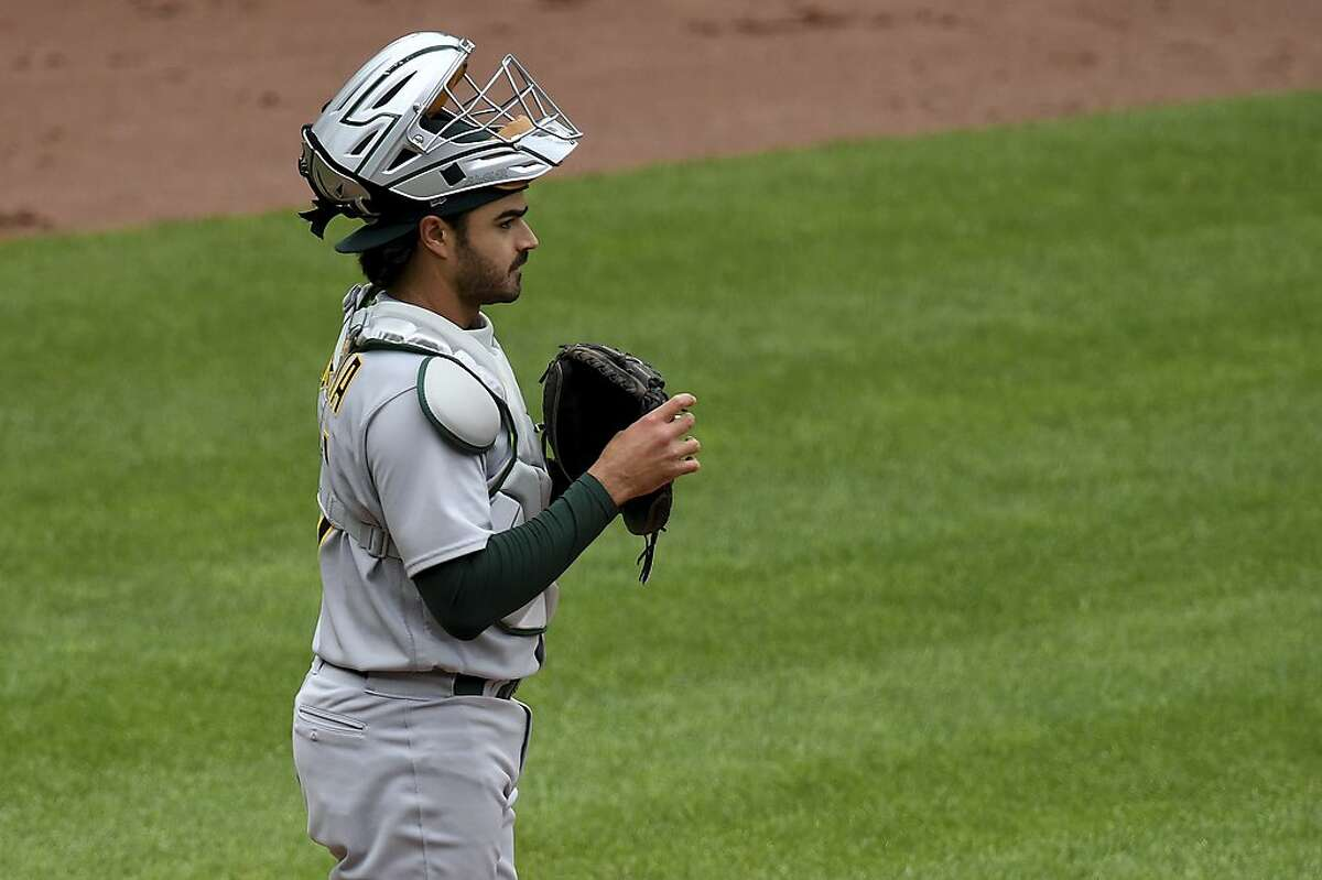 Oakland Athletics' Aramis Garcia looks on between innings against the Baltimore Orioles during a baseball game, Sunday, April 25, 2021, in Baltimore. (AP Photo/Will Newton)