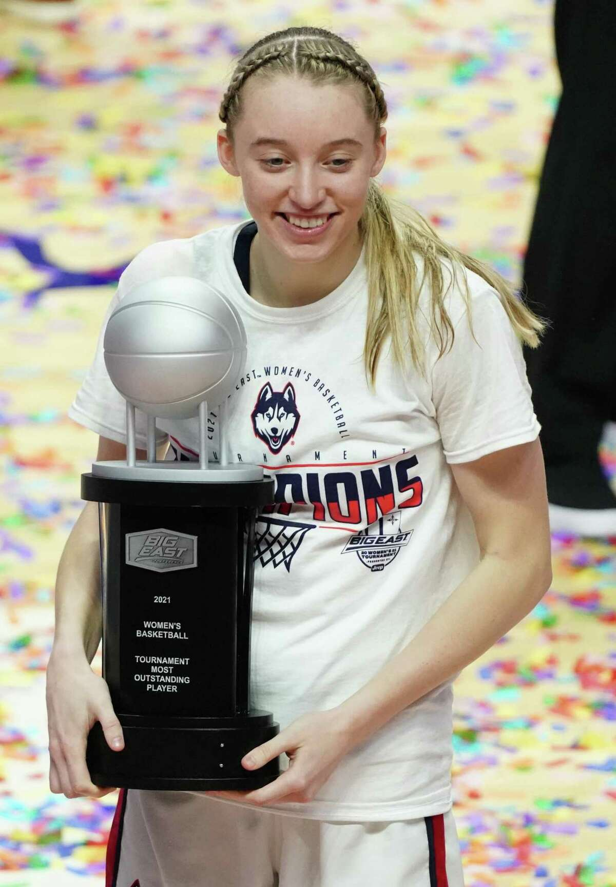 UConn's Paige Bueckers holds the Most Oustanding Player trophy after winning the Big East Tournament. Bueckers is recovering from ankle surgery and experts say the prognosis is good.