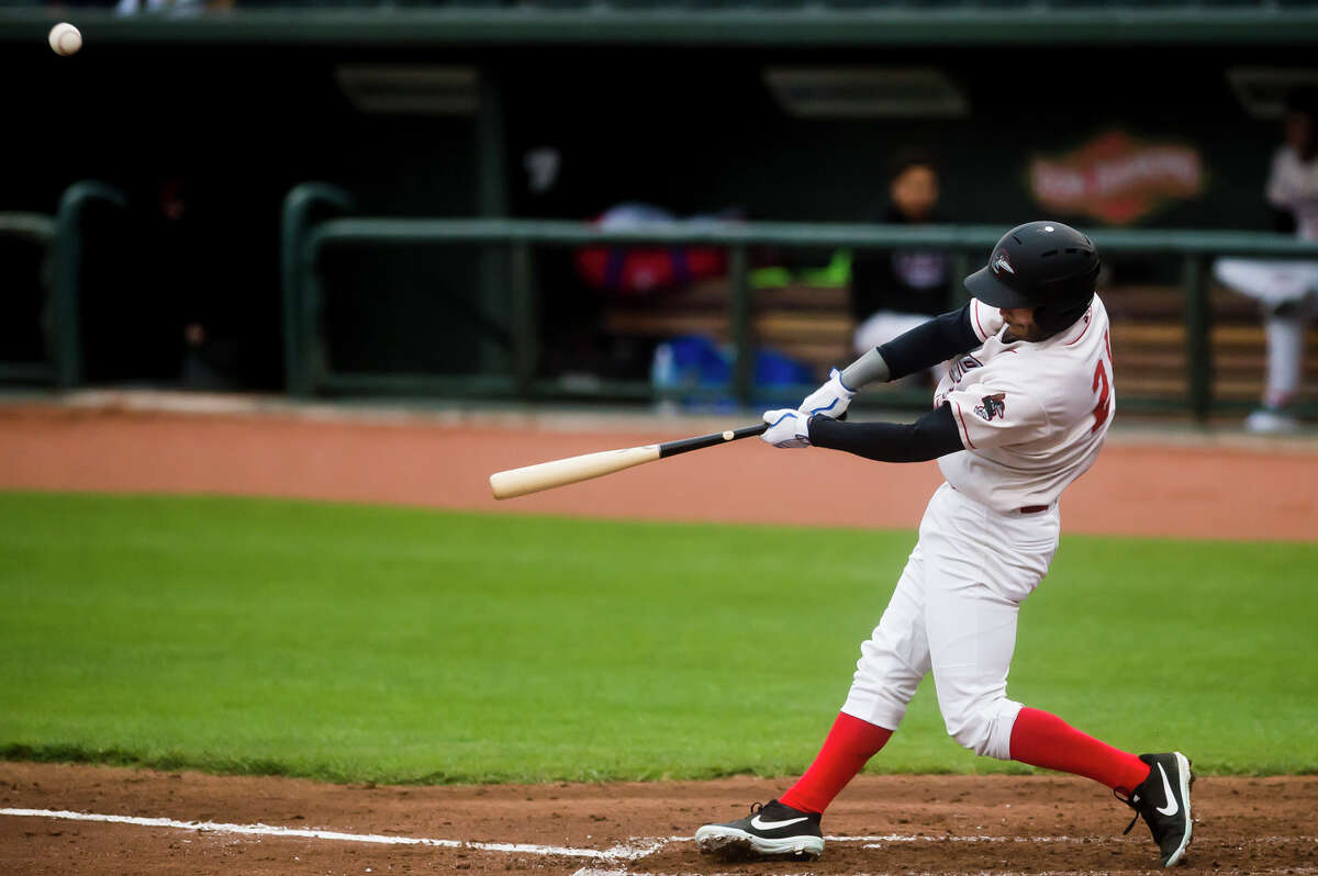 Great Lakes Loons infielder Justin Yurchak swings on a pitch during the Loons' opening day game against Dayton Tuesday, May 4, 2021 at Dow Diamond in Midland. (Katy Kildee/kkildee@mdn.net)