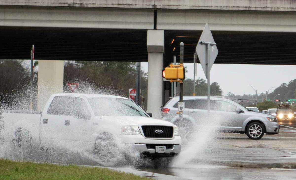 As water-related issues continue to see increased public awareness, members of The Woodlands One Water Task Force are keeping busy. In this file image, cars drive through standing water in January 2019 at the intersection of Texas Texas 242 and Interstate 45.