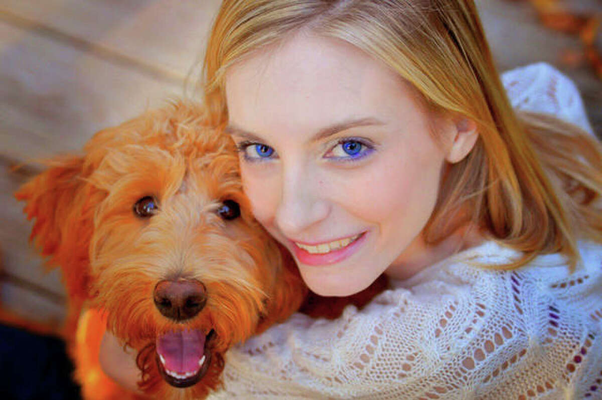 Edwardsville resident Sarah Kathryn Frey and her Double Doodle service dog, Alice Eloise. Frey, who has struggled with severe illness and disability for most of her life, has written a new children's book inspired by her relationship with Alice Eloise.