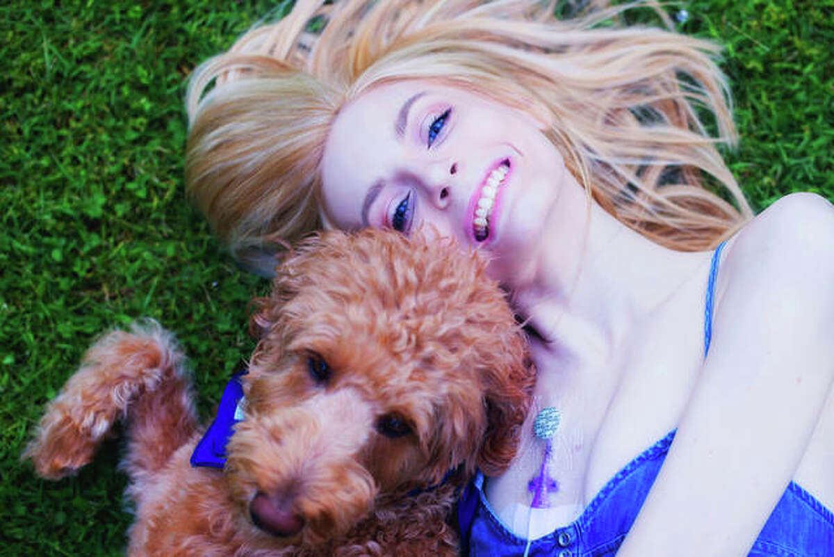 """Edwardsville resident Sarah Kathryn Frey has struggled with severe illness and disability for most of her life. Her new book, """"Alice Eloise's Silver Linings: The Story of a Silly Service Dog,"""" is inspired by her beloved Double Doodle service dog."""