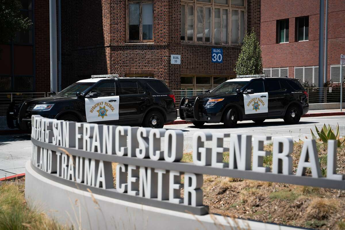 Highway patrol vehicles are parked outside San Francisco General Hospital. The high profile of law enforcement in the hospital setting upsets many, who believe mental health crises can be more effectively and humanely handled by health professionals, not police. A proposed policy may make that happen.
