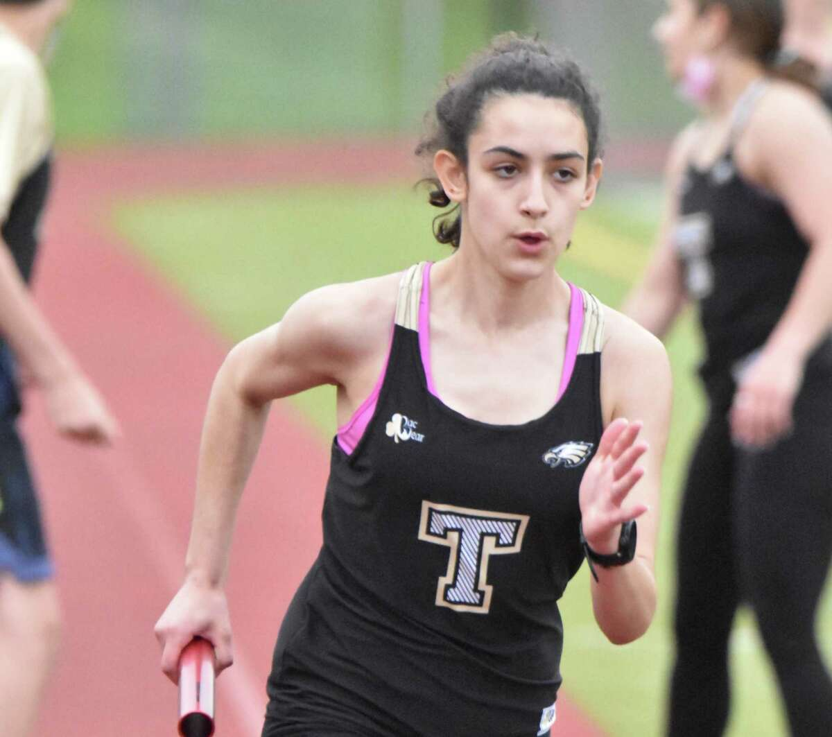 Evelyn Marchand won the 400 and 3200 meters and was a member of the winning 4x400 meter relay team in Trumbull's meet with Stamford.