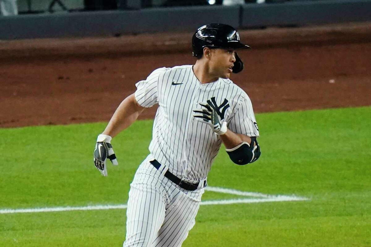 New York Yankees' Giancarlo Stanton rounds first base on a RBI single during the sixth inning of a baseball game against the Houston Astros Tuesday, May 4, 2021, in New York. (AP Photo/Frank Franklin II)