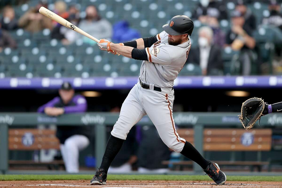 DENVER, COLORADO - MAY 04: Brandon Belt #9 of the San Francisco Giants hits a 2 RBI home run against the Colorado Rockies in the first inning during game two of a double header at Coors Field on May 04, 2021 in Denver, Colorado. (Photo by Matthew Stockman/Getty Images)