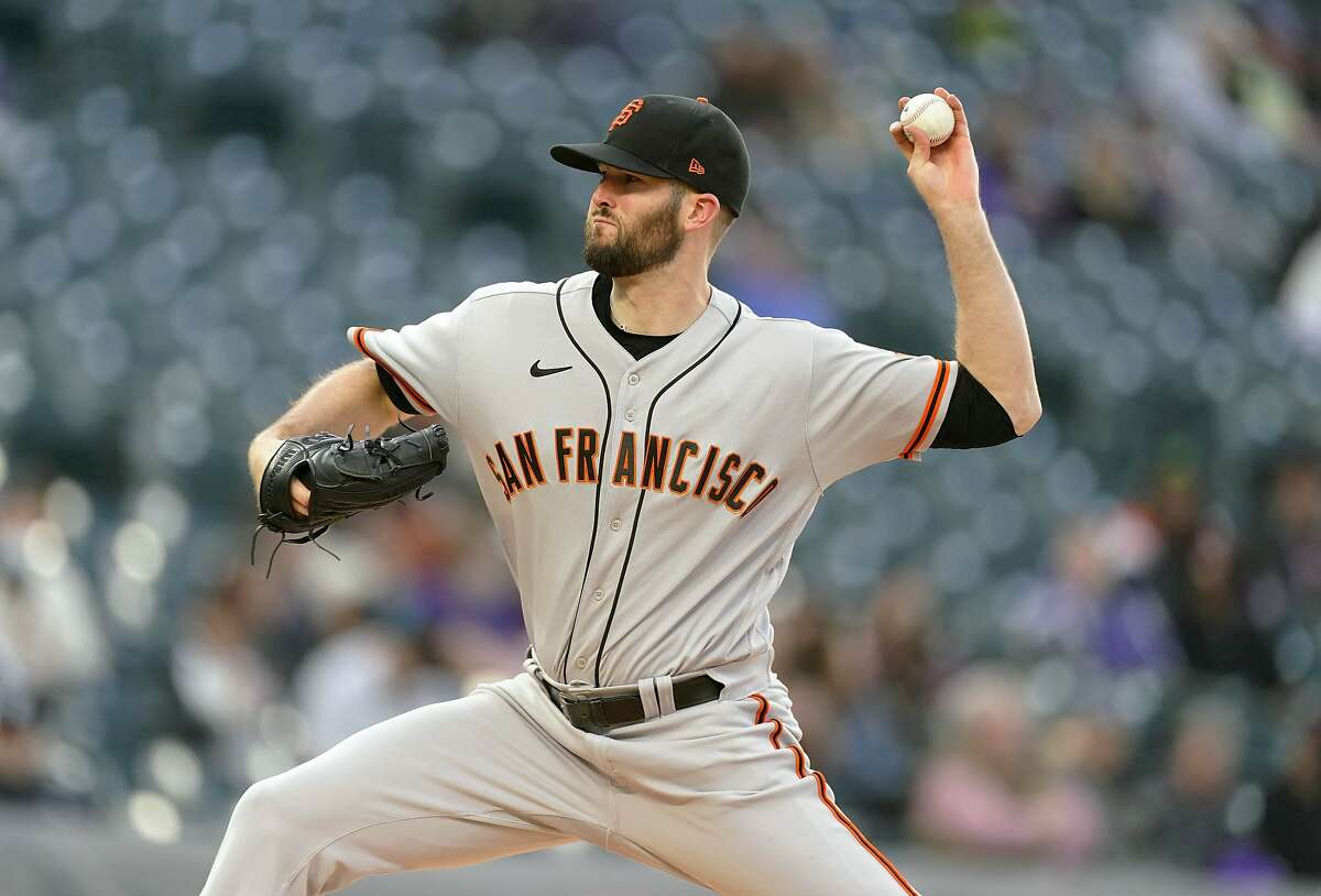 San Francisco Giants starting pitcher Alex Wood works against the Colorado Rockies in the first inning of game two of a baseball doubleheader Tuesday, May 4, 2021, in Denver. (AP Photo/David Zalubowski)