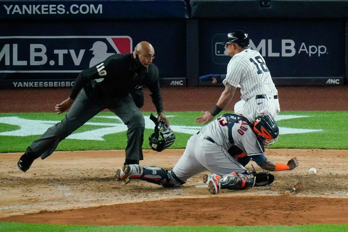 Yankees runner Rougned Odor collides with Astros catcher Martin Maldonado during the sixth inning of Tuesday's game as he scored New York's sixth run.