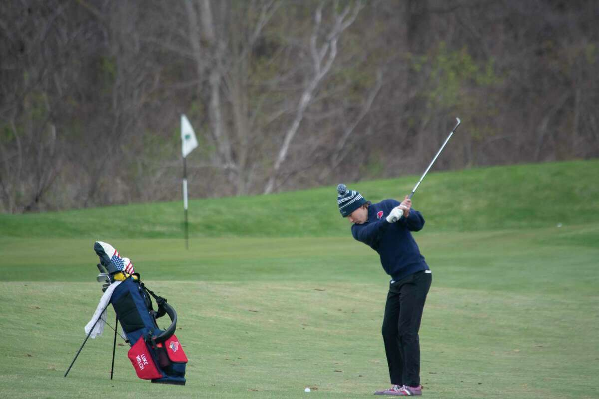 Pictured is Big Rapids' Luke Welch hitting an approach shot in Tuesday's match. (Courtesy photo)