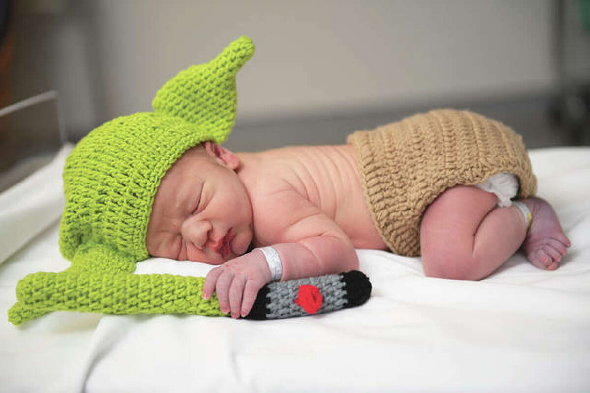 Zayne Damon Courtwright, the child of Janet Gregory and Shane Courtwright, sleeps in a Baby Yoda outfit at Passavant Area Hospital on Tuesday. Baby Yoda is a popular character from the Star Wars'