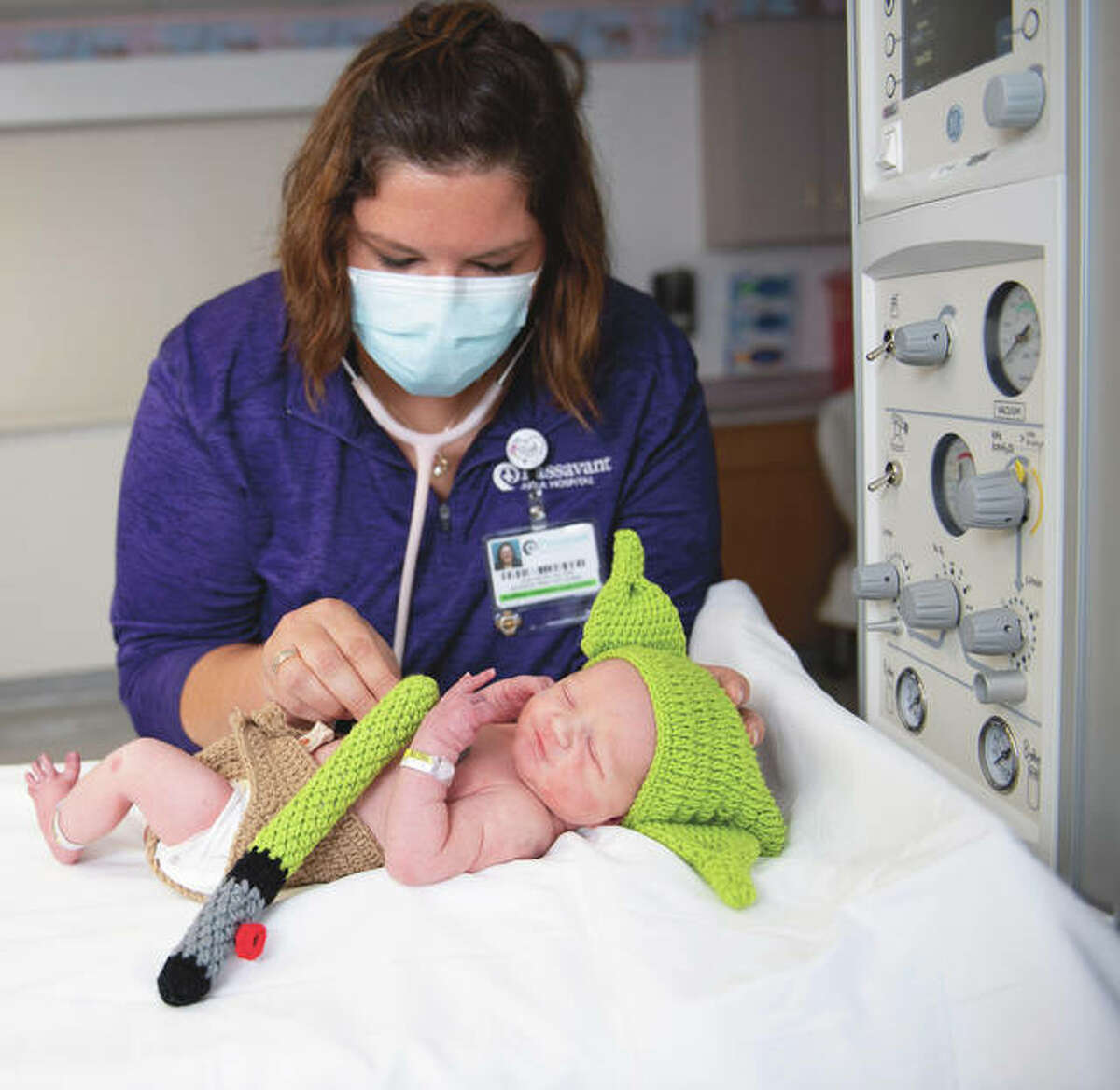 A Passavant Area Hospital nurse tends to newborn Joseph Ryan Bull, born to John and Courtney Bull at 8:59 a.m. Tuesday. Memorial Health System hospitals celebrated Tuesday births with Baby Yoda outfits in celebration of Star Wars Day, when the catch-phrase