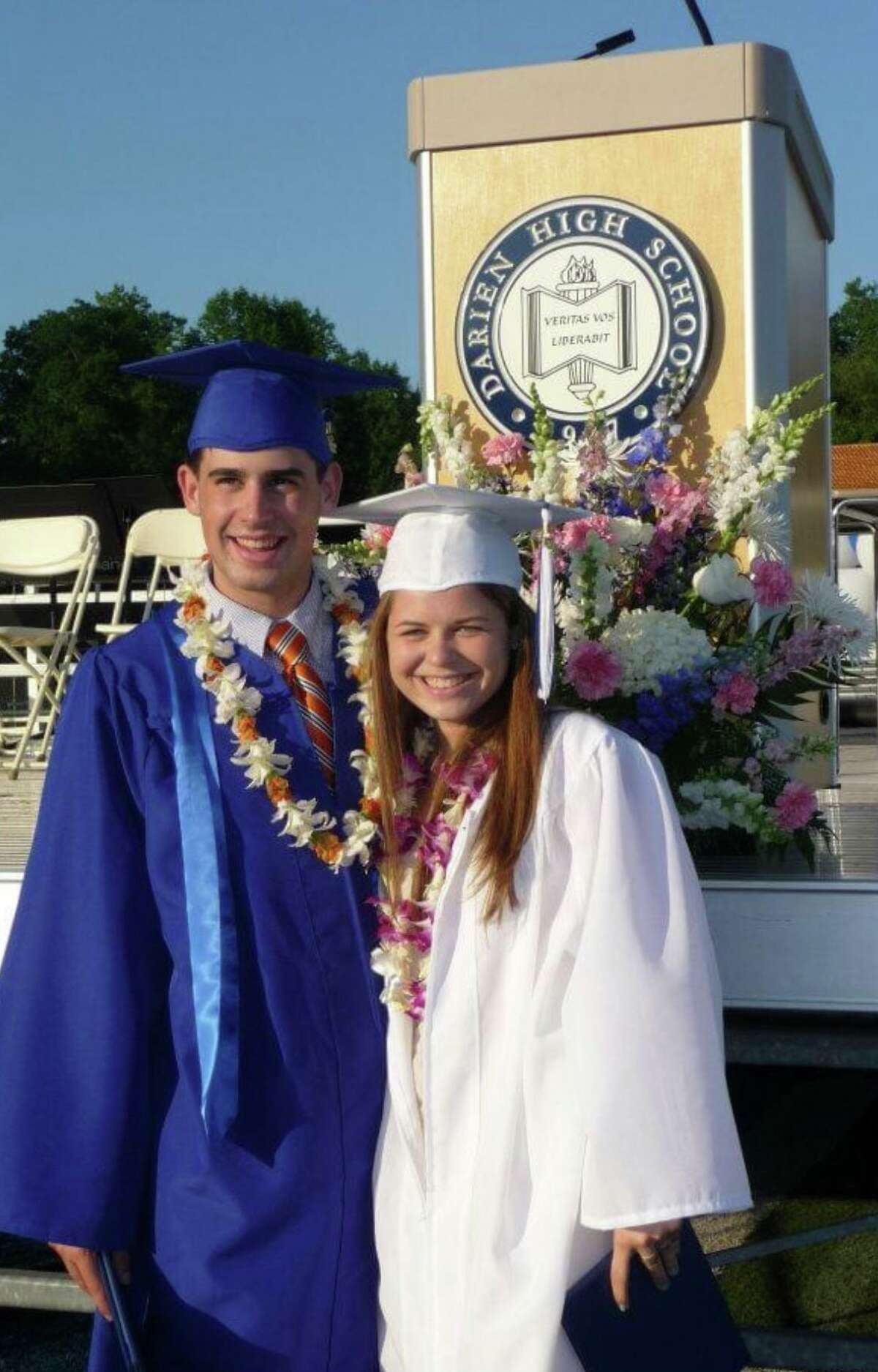 Darien High alum Jay Alter, shown here with fellow Class of 2012 member Liz, now his wife, at their graduation. The couple got engaged at Weed Beach.