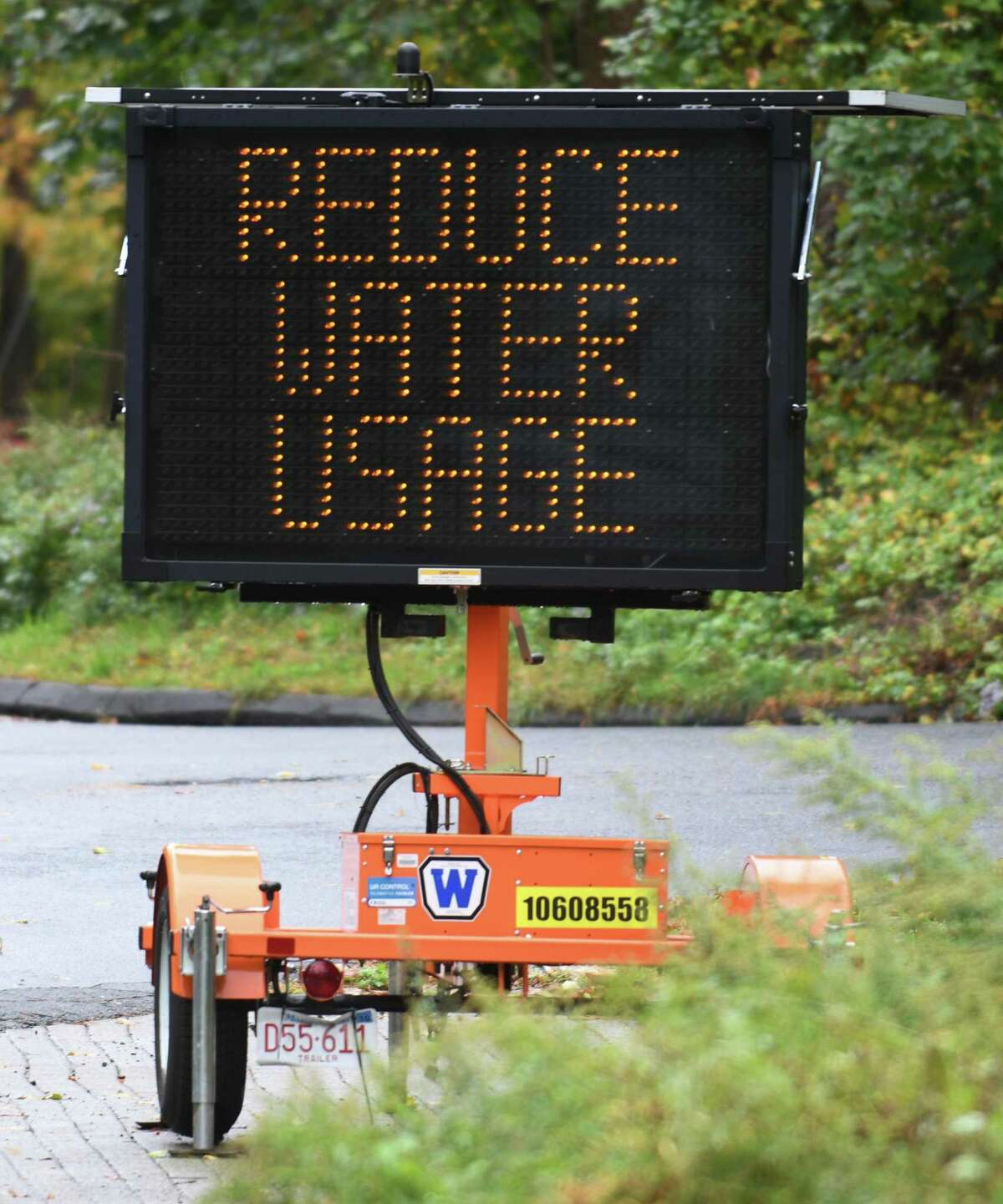 A sign urges residents to reduce water usage near Putnam Reservoir in Greenwich, Conn. Monday, Oct. 12, 2020.